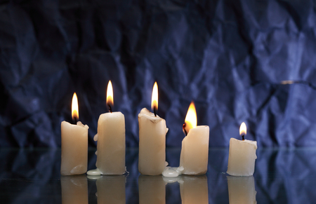 Set of lighting candles with fire and smoke on nice dark background Stok Fotoğraf