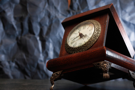 Old wooden casket with clock on nice gray background Stock Photo
