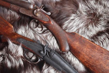 gunsight: Ancient hunting shotguns closeup on nice fur background Stock Photo