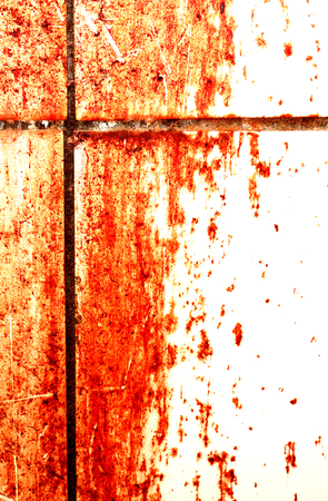 Blood flow on white tiled wall with free space for text