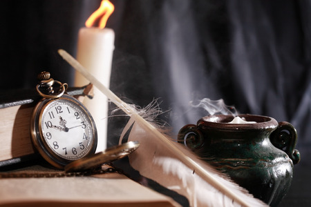 Vintage still life with lighting candle near old things Standard-Bild