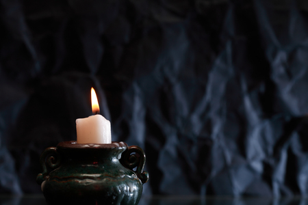 One lighting candle with reflection against dark background Stok Fotoğraf