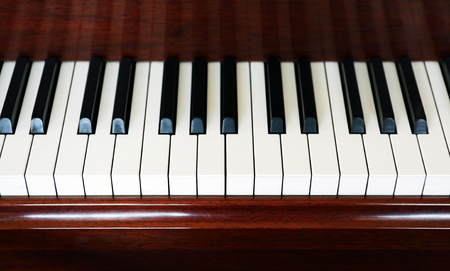 Closeup of old piano white and black keys as background 写真素材