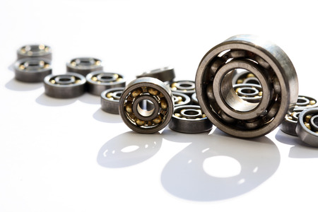 Industrial concept. Lot of ball bearings on white background Stock fotó