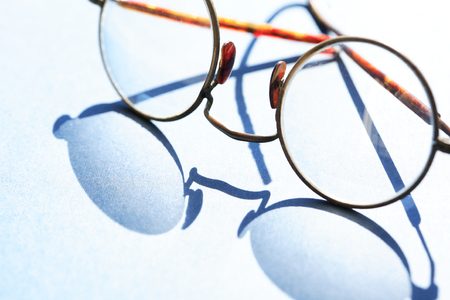 Old spectacles with shadow against sun light