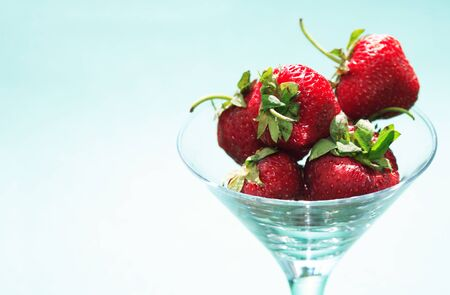 Few strawberry fruits in nice glass bowl