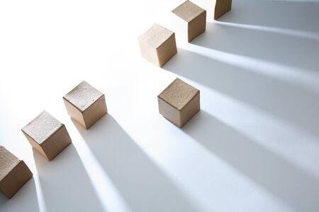 One cardboard cube against cubes in a row Reklamní fotografie