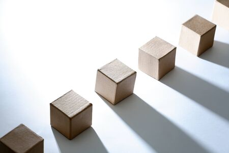 Set of cardboard cubes on white background with light and shadows Reklamní fotografie