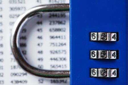 Financial security concept. Combination lock on white plastic card with digits Reklamní fotografie