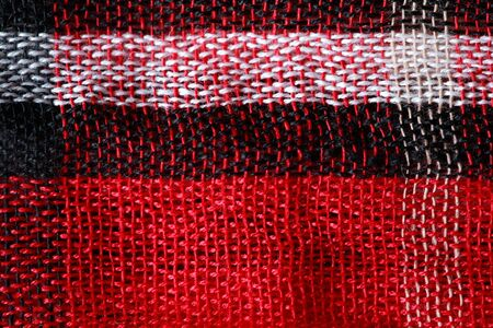 Bright cloth background. Closeup of traditional Middle East fabric Фото со стока