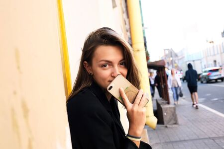 Beauty young woman against midday town background 写真素材 - 129805776
