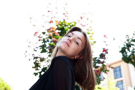 Beauty young woman against white background with tree 写真素材