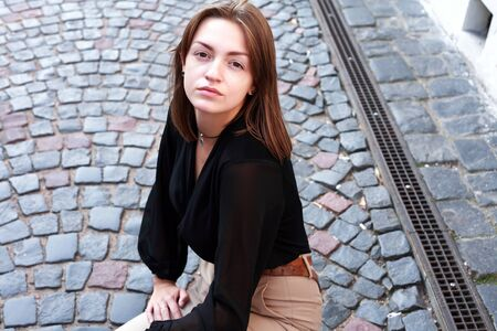 Beauty young woman against nice gray pavement background