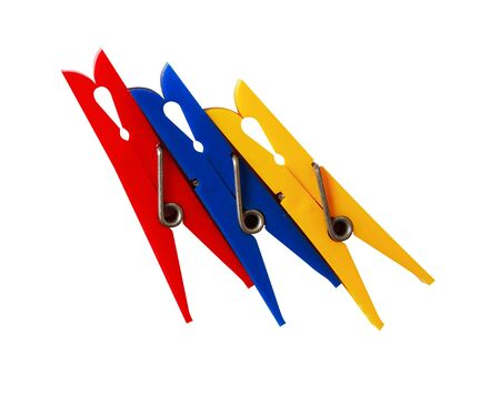 Three various plastic clothespins on white background