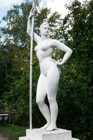 Classical Soviet art. Girl with a paddle statue in garden