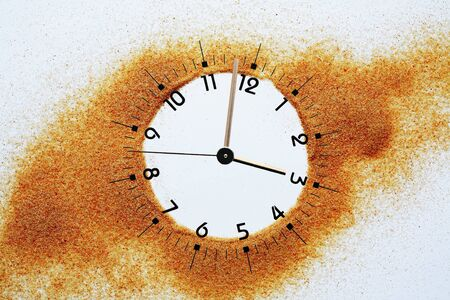 Abstract composition with clock dial inside sand flowing background