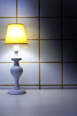 Elegance white desk lamp with yellow lampshade Фото со стока