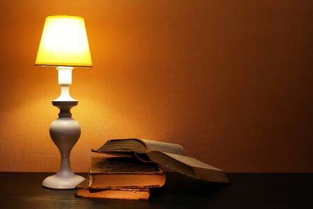 Elegance white desk lamp with yellow lampshade near open book