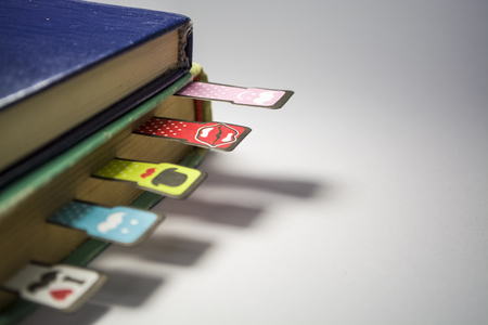 Old books on a white background. Cheerful and amusing bookmarks with moustaches of different coloring.
