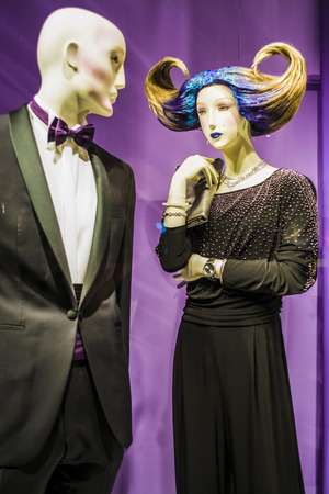 Two unusual dummies and original hairstyle. The girl with blue hair and in a black dress.