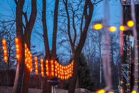 Various bright Chinese small lamps in the park. Garland. An unusual decor for streets and the house. Festive mood. Stock fotó