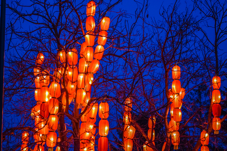 Various bright Chinese small lamps in the park. Garland. An unusual decor for streets and the house. Festive mood. Reklamní fotografie