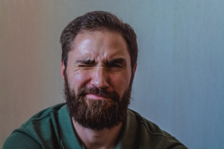 Various emotions on a face at the young bearded European man. Different mood Banco de Imagens