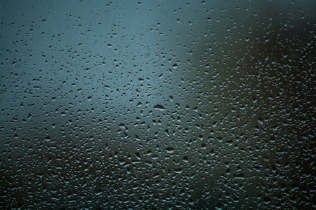 Background or texture. It is a lot of small a rain drops on window glass. Rainy day of spring