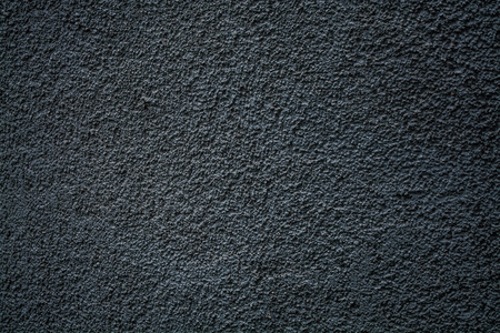 Gray monophonic background or texture with roughness. Blue shade. Plaster on a wall Reklamní fotografie