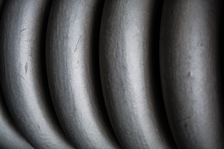 Plait, spiral gray thick from metal, for maintenance of construction elements. Spring. Texture or a background in monophonic tones. Reklamní fotografie