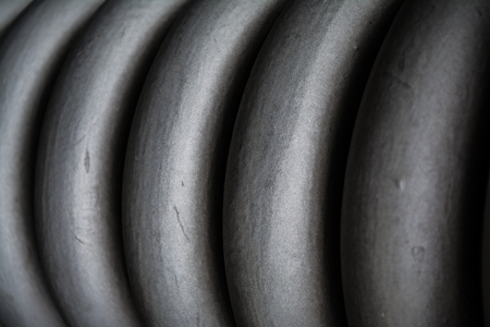 Plait, spiral gray thick from metal, for maintenance of construction elements. Spring. Texture or a background in monophonic tones. Stok Fotoğraf