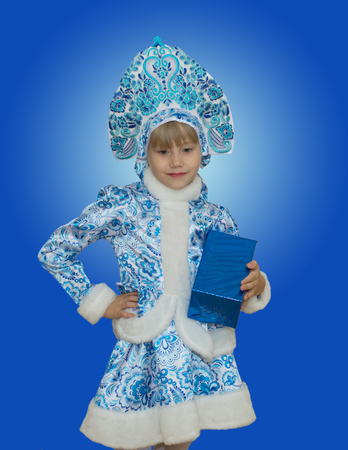 beautiful little girl in suit Snow Maiden. New Year and Christmas. Beautiful gift. Stock Photo