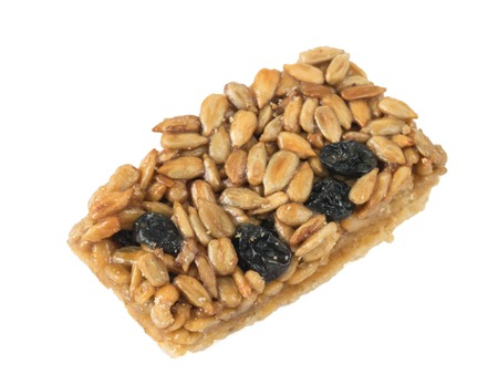 platanos fritos: Cookies with peanuts, sunflower seeds and dried grapes. Isolated on white background. A nutritious breakfast.