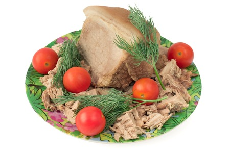 charcutería: Small piece of boiled pork on a plate with cherry tomatoes. Ready-made charcuterie.