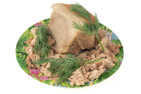 Boiled pork on a plate with dill. The basis for the preparation of meat soup.