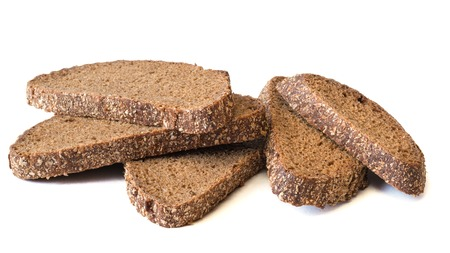 Fresh bread from wholemeal flour isolated on a white background. Scalded bread with bran. Healthy diet food.