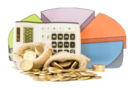 Metal coins, calculator and a schedule of expenses isolated on white background. The concept of budget allocation. Stock Photo