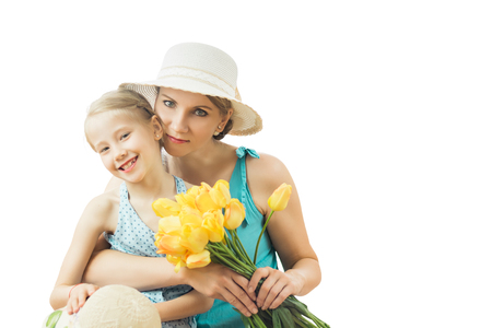 tenderly: Little girl tenderly embraces his mother isolated on white background. The concept of family happiness.
