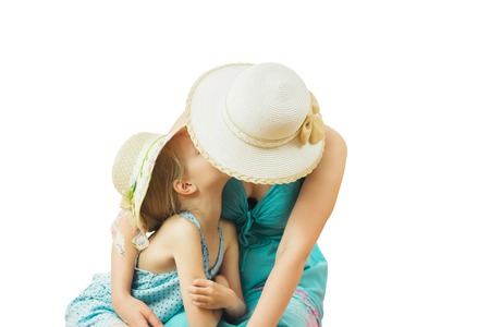 Little girl tenderly embraces his mother isolated on white background. The concept of family happiness.
