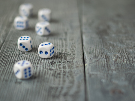 Dice blue and white color on wooden rustic table. Accessories for Board games. Stock Photo