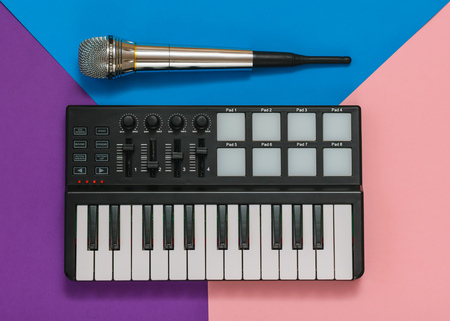 Musical mini mixer and microphone on a background of three colors. Equipment for the music Studio. The view from the top. Flat lay. Stok Fotoğraf