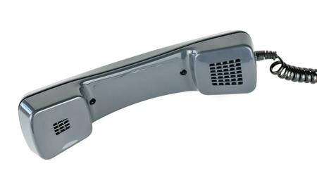 Zwarte handset van vintage telefoon met snoer geïsoleerd op een witte achtergrond. Oude communicatiemiddelen. Stockfoto