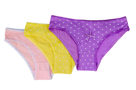 Pink, purple and yellow womens briefs isolated on white background. Fashionable concept. Beautiful lingerie. Flat lay The view from the top.