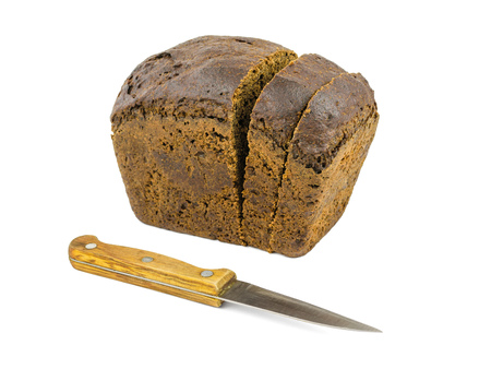 A loaf of coarse flour bread with a knife isolated on a white background. The product of grains beneficial to health. Stok Fotoğraf - 121683707