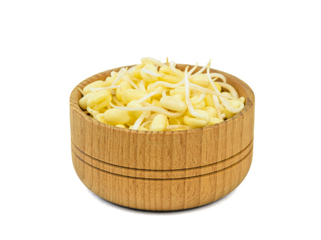 Mung bean sprouts in wooden Cup isolated on white background. Sprouted grains for a healthy diet. Stock Photo