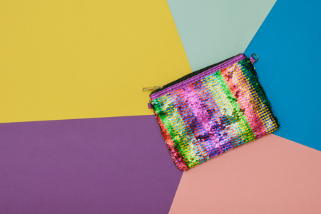 Womens bag rainbow color on a background of five colors. Fashion womens accessory. Flat lay. The view from the top. Banco de Imagens