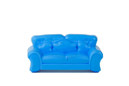 Toy modern blue beautiful sofa isolated on white background. A sample of beautiful furniture for the house. Minimalism.