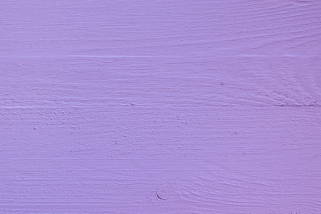 Background of bright painted lilac wooden boards. Minimalism. Wallpaper in the form of a tree texture.