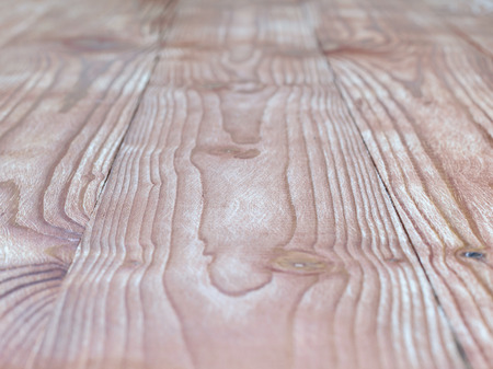 The background of a wooden table with a pronounced texture. Blank for design.