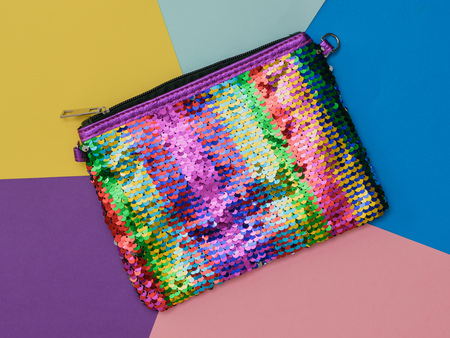 Bag with rainbow colors on a colorful background. Flat lay.